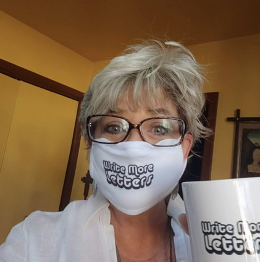 A white Flea Market Love Letters face mask sold on Bonfire
